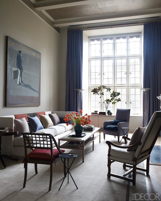 apartment living room, large windows, oversize art