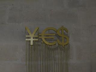 YES מורכב מממטבעות ין אירו ודולר