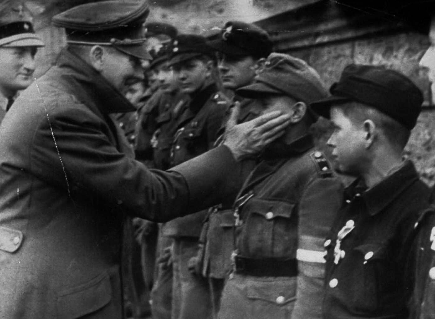 Adolf Hitler touches the face of Wilhelm