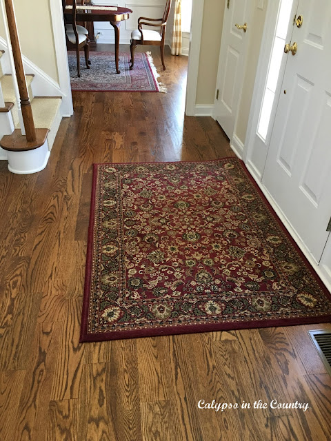 Red rug in foyer