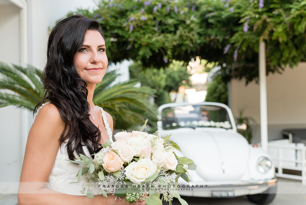 Bride and vintage wedding car