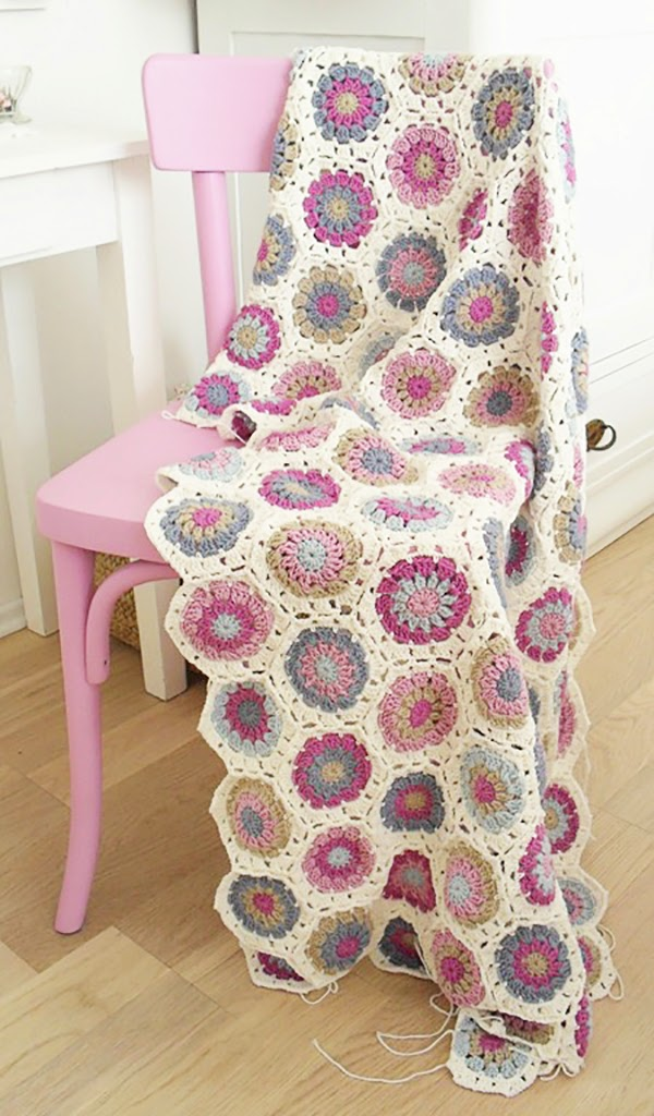 Crochet blanket on a painted pink chair