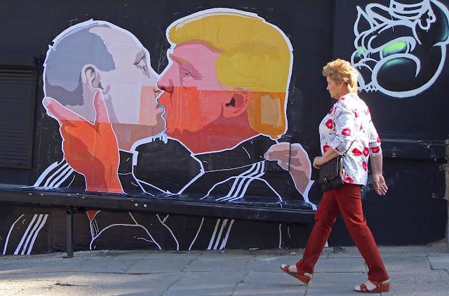 Donald Trump kisses Vladimir Putin