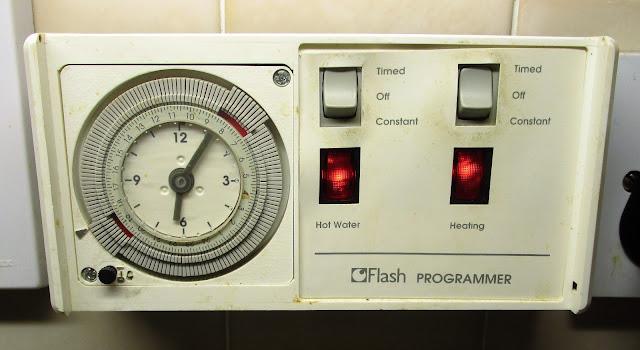 öljylämmitys, lämmitysmittari, kello, kuumavesilämmitys