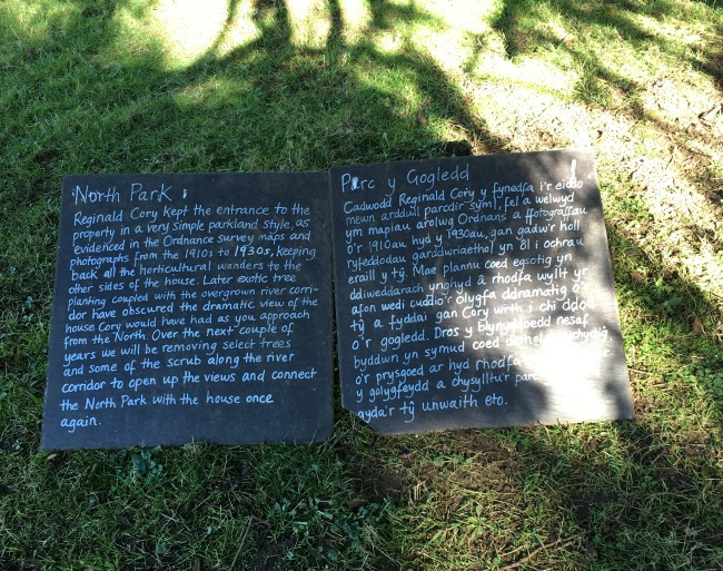 slate signs describing the history of the North Park in English and welsh