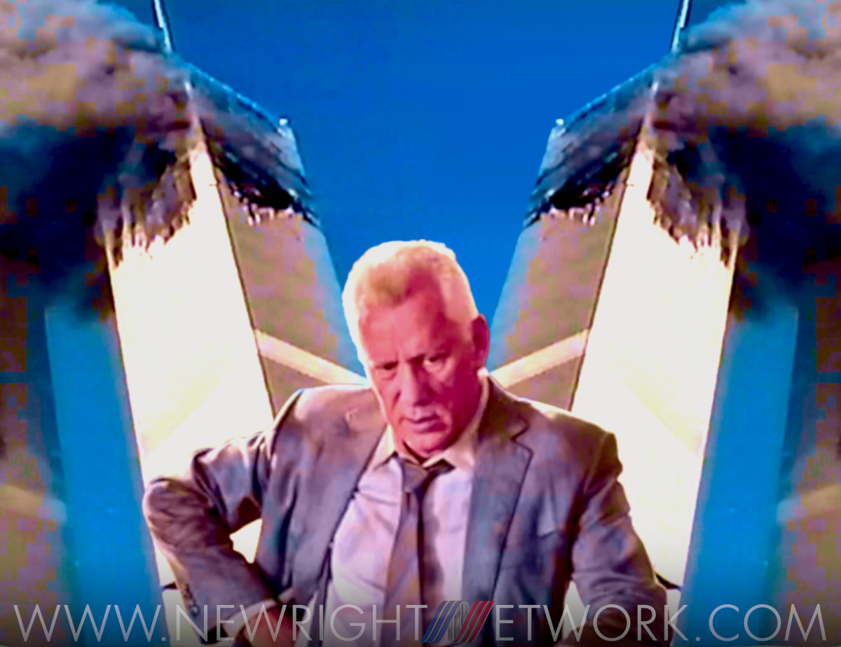 James Woods standing in front of the twin towers while they're on fire, looking disappointed