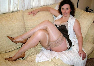 sexy older babe in stocking laying on sofa