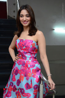 Actress Tamanna Latest Images in Floral Short Dress at Okkadochadu Movie Promotions  0028.JPG
