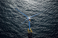 A wind turbine in the waters off Block Island, Rhode Island, U.S. (Photograph Credit: Eric Thayer/Bloomberg) Click to Enlarge.