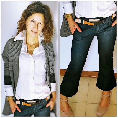 Dettaglio camicia bianca e jeans crop