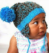 http://www.ravelry.com/patterns/library/baby-hat-with-puffy-pom-poms---knit-pdf-pattern