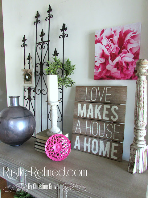 Spring home decor in the foyer. Adding that rustic style with metals, color and garden accents