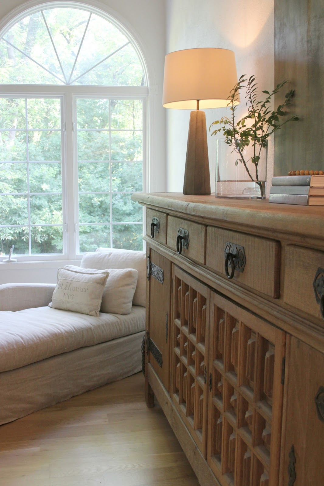 Belgian linen chaise and rustic antique Belgian sideboard in my light and bright European country living room with white oak hardwoods - Hello Lovely Studio.