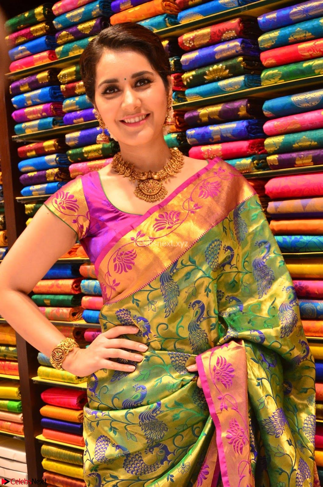 Raashi Khanna in colorful Saree looks stunning at inauguration of South India Shopping Mall at Madinaguda