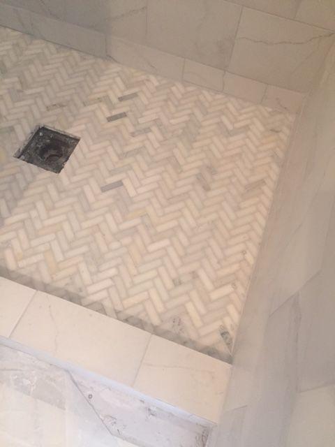 Herringbone marble tile in shower floor under construction, Hello Lovely Studio