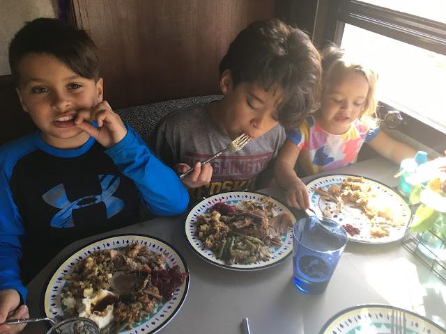 Kids enjoying Thanksgiving meal