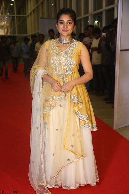 Nivetha Thamos in bright yellow dress at Ninnu Kori pre release function ~  Exclusive (1).JPG