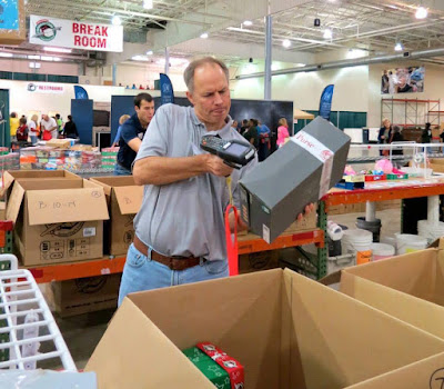Scanning shoeboxes at Operation Christmas Child processing center
