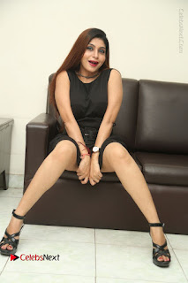 Tollywood Upcoming Actress Pooja Roshan Stills in Black Short Dress at Plus 1 Movie Trailer Launch  0349.JPG