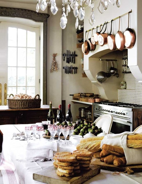This country french style kitchen is accented with copper and browns for a warm, inviting feeling