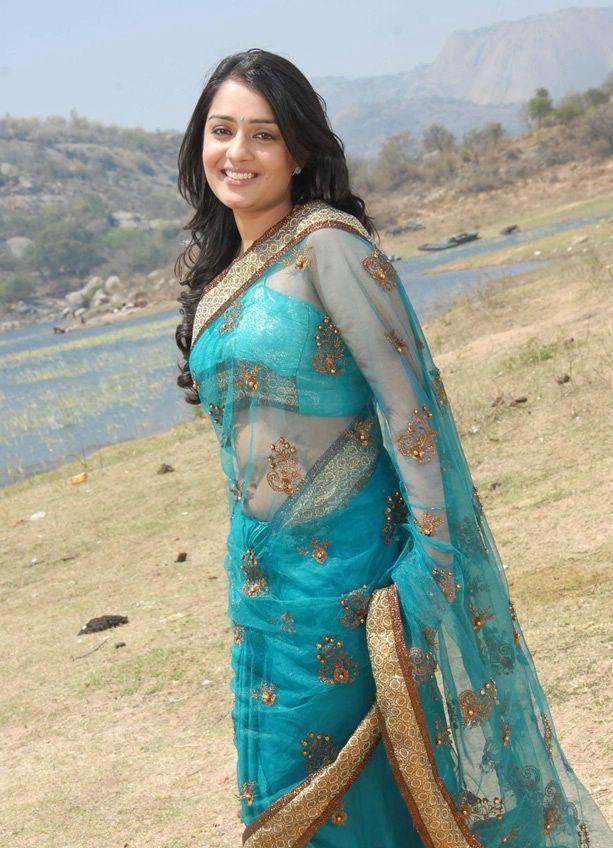 Nikitha in a designer transparent saree sexy navel