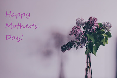 Happy Mother's Day! image with flowers and a purple background