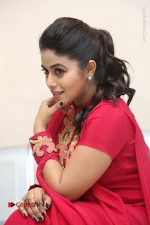 Actress Poorna Latest Stills in Red Dress at Rakshasi First Look Launch  0258.JPG