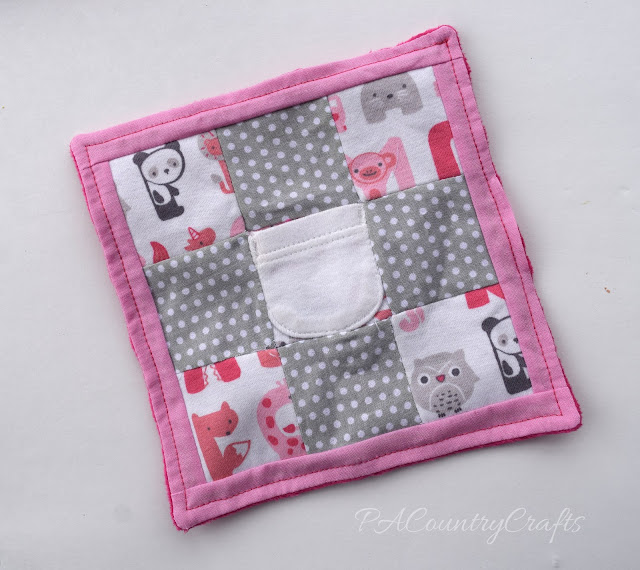 Mini quilt made from baby clothes