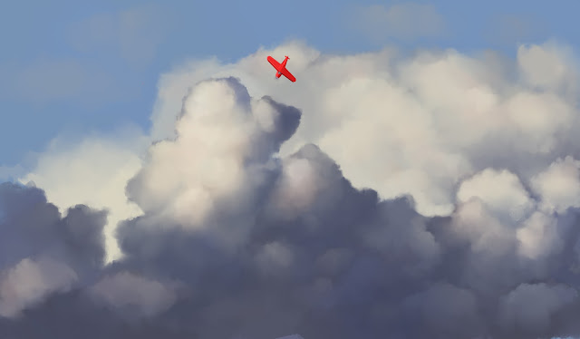 Plane flying in clouds