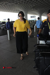 Actress Huma Qureshi Pictures in Black Skirt at Mumbai Airport  0003
