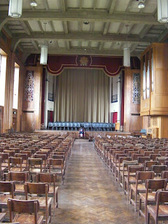 merchant taylors school great hall with stage, organ and assembly seating