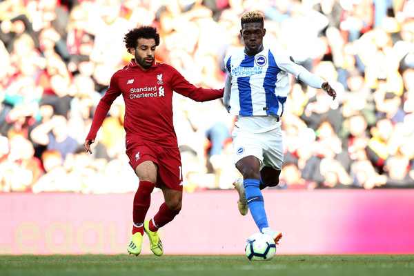 Mohamed Salah of Liverpool battles for posession with Yves Bissouma of Brighton and Hove Albion during the Premier League match between Liverpool FC and Brighton & Hove Albion at Anfield on August 25, 2018 in Liverpool, United Kingdom.
