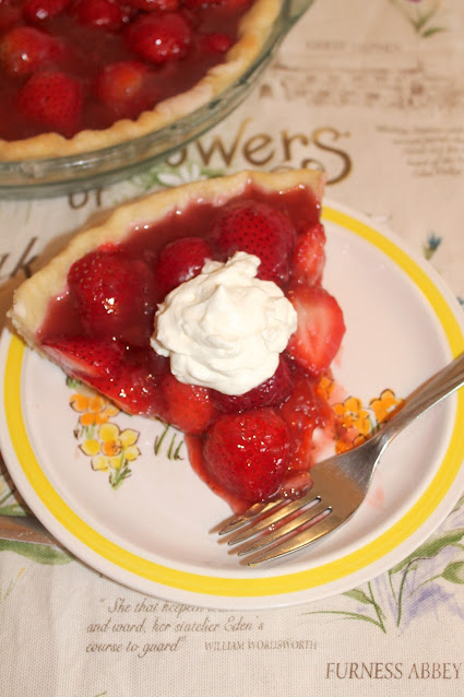 Fresh Strawberry Pie with a slice on a plate.
