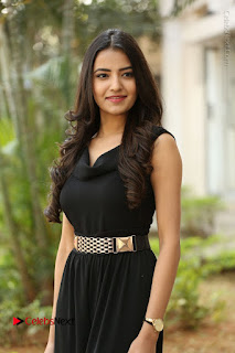 Telugu Actress Rukhsar Mir Stills in Black Long Dress at Aakatayi Movie First Look Launch  0042.JPG