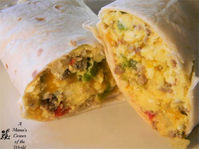 Egg Sausage Peppers and Onions wrapped into a flour tortilla for a breakfast burrito