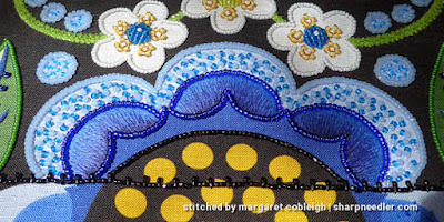 Light blue petals filled with para, a Japanese bead embroidery technique that uses two beads like a seed stitch. (Wild Child Japanese Bead Embroidery by Mary Alice Sinton)
