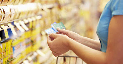 Low income woman using coupons