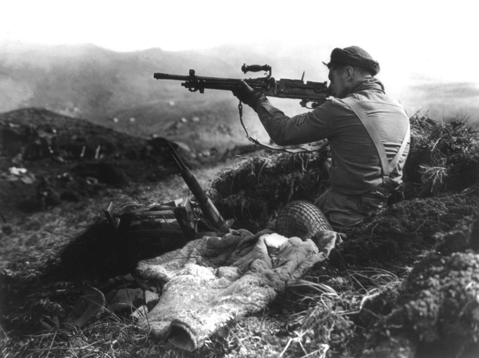 A Canadian member of the joint American-Canadian landing force squints down the sights of a Japanese machine gun found in a trench on Kiska Island, Alaska, on August 16, 1943. After the brutal fighting in the battle to retake Attu Island, U.S. and Canadian forces were prepared for even more of a fight on Kiska. Unknown to the Allies though, the Japanese had evacuated all their troops two weeks earlier. Although the invasion was unopposed, 32 soldiers were killed in friendly-fire incidents, four more by booby traps, and a further 191 were listed as Missing in Action.