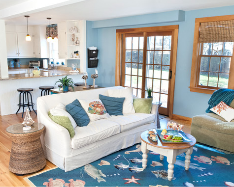 Anchored around a sea life rug, this blue coastal living room by Angela  Hagerty from InDesign Interiors features some outstanding decor -an under  the sea ...