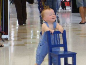 Image: Baby running off with a chair. Photo credit: Jasmine Adams