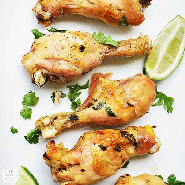 Slow Cooker Cilantro Lime Chicken Drumsticks on a white serving tray - top view looking down