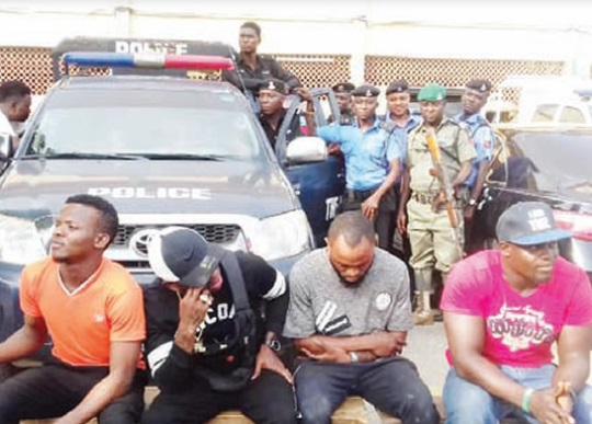Small Doctor (2nd left) and his arrested armed band members