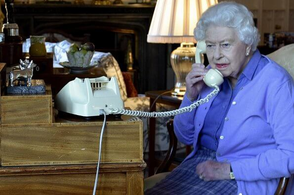 Queen Elizabeth was photographed using an old fashioned telephone at Windsor Castle while talking to Boris Johnson