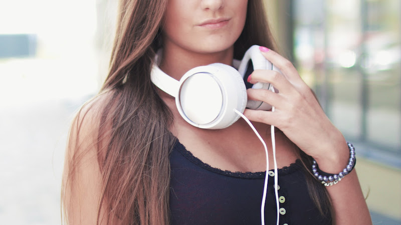 Girl Listen in Headphones Good Music