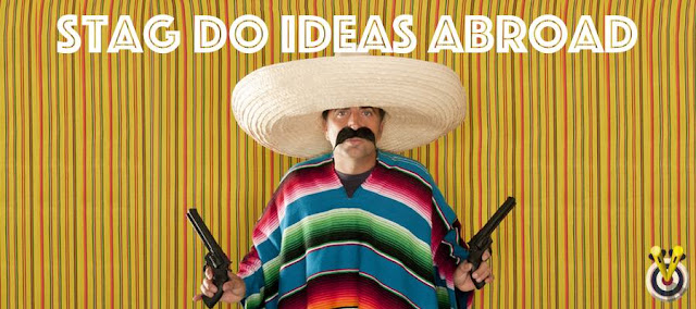 Man dressed up in a mexican fancy dress with pretend pistols