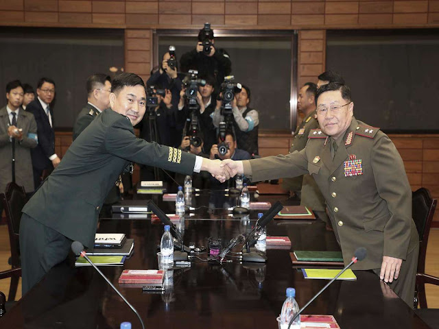 Two Koreas agree to remove some border guard posts