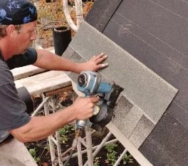Properly aligning the shingle strip over the end of the roof and pressing by nails to the boards