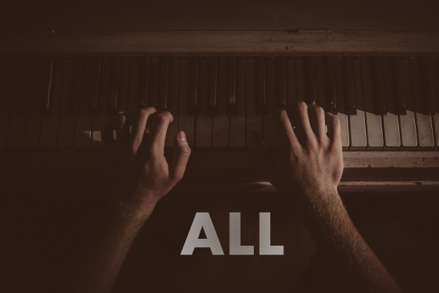 Image of a man playing piano. The word all is written on the picture.