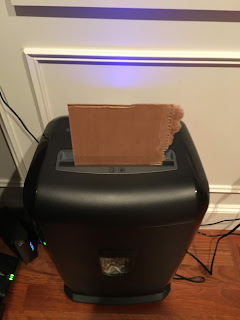 Photo of cardboard feeding into paper shredder. https://trimazing.com/