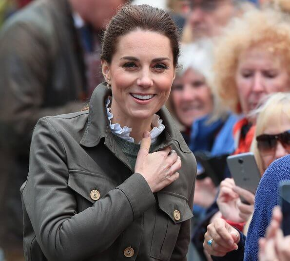 Kate Middleton is wearing chunky boots by Chloe, and a jacket by Troy of London, Kiki McDonough gold diamond earrings